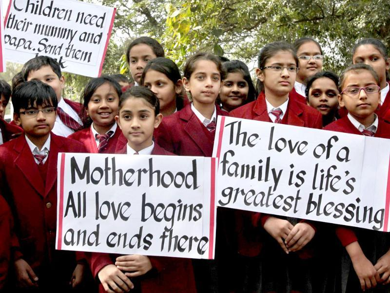 School children holding placards during a demonstration for the return of two children currently under the care of Norwegian social workers outside the Norwegian embassy in New Delhi. (PTI / Atul Yadav)
