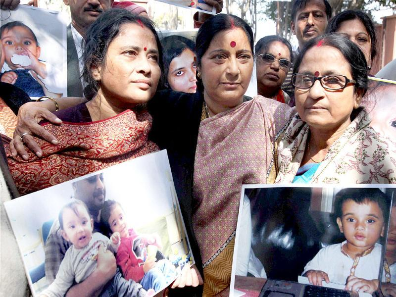 BJP leader Sushma Swaraj with grand parents of NRI children Aishwarya and Abhigyan during protest demanding their return from Norway, outside the Norwegian Embassy in New Delhi. (PTI Photo / Atul Yadav)