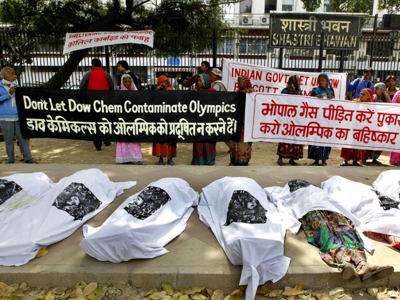 Victims of the 1984 Bhopal Gas tragedy pose as dead bodies during a protest against Dow Chemicals sponsorship of the London 2012 Olympics. AP/Saurabh Das