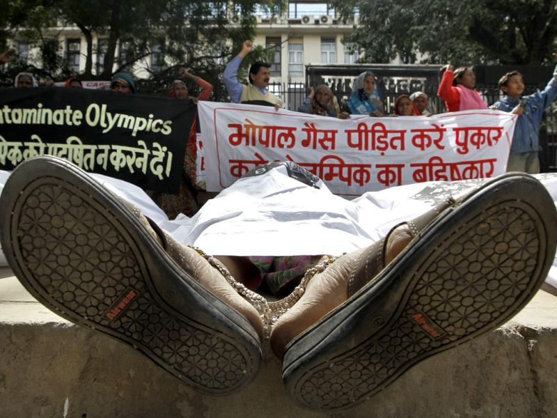 Victims of the 1984 Bhopal Gas tragedy pose as dead bodies during a protest outside the sports ministry demanding cancellation of Dow Chemicals sponsorship of the London 2012 Olympics, in New Delhi. AP/Saurabh Das