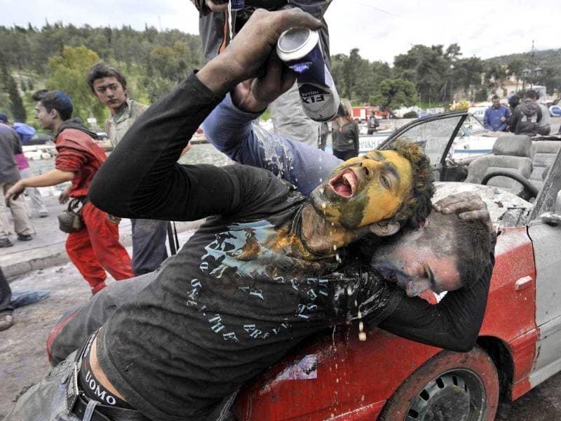 Revellers enjoy the celebrations of the Clean Monday or Ash Monday in Galaxidi, celebrated with a flour war, some 240 km west of Athens. AFP Photo/Louisa Gouliamaki