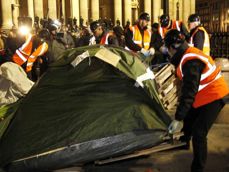 Bailiffs remove tents from the Occupy encampment in front of St Paul's Cathedral in London. (Reuters/Chris Helgren)