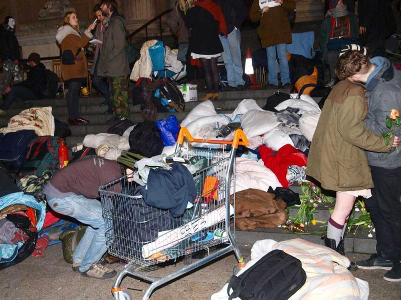 Activists try to save some of their belongings as City of London Corporation bailiffs, backed by police, remove tents and other structures from the square in front of St. Paul's Cathedral, where anti-capitalist protesters have been camped since mid-October in London. (AP Photo/PA, Max Nash)