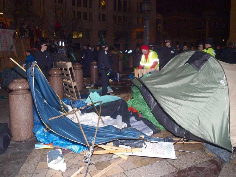 City of London Corporation bailiffs, backed by police, remove tents and other structures from the square in front of St Paul's Cathedral, where anti-capitalist protesters have been camped since mid-October in London. (AP Photo/PA, Max Nash)