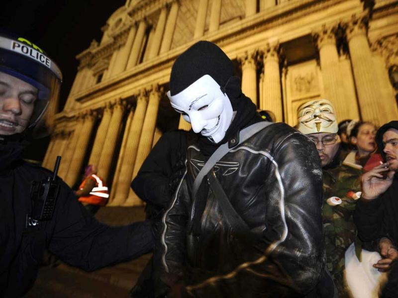 Riot police removes a protester wearing a Guy Fawkes mask from the Occupy encampment on the steps of St Paul's Cathedral in London. (Reuters/Dylan Martinez)
