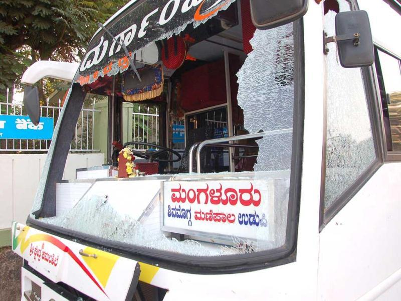 A private bus with a smashed windscreen in stone throwing by supporters of the countrywide general strike called by trade unions, in Mangalore on Tuesday. More than 10 private and KSRTC buses were damaged.