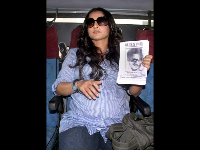 Vidya, whose screen name is the same, holds up the picture of her on-screen husband Arnab Bagchi.