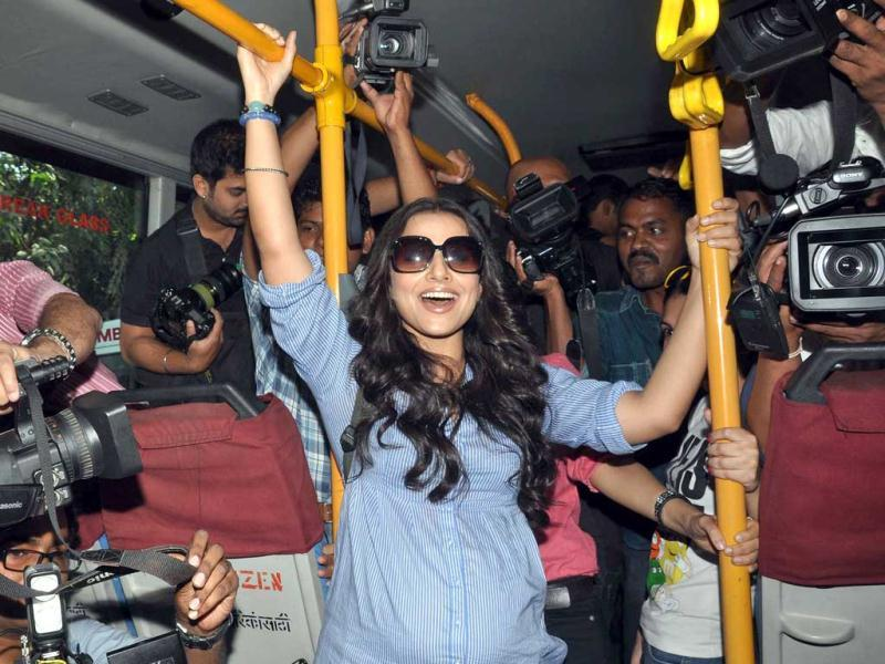 The actor was surrounded by photographers in an already crowded bus as she ventured out to promote her film.