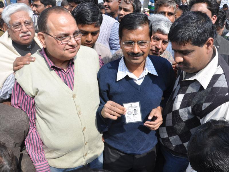 Team Anna member Arvind Kejriwal shows his voters ID card. HT/Sakib Ali