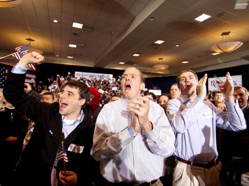 Supporters of Republican presidential candidate, former Massachusetts governor Mitt Romney, cheer in reaction to news that Romney was the projected winner in the Arizona primary, at his election watch party in Novi, Mich. AP Photo/Gerald Herbert