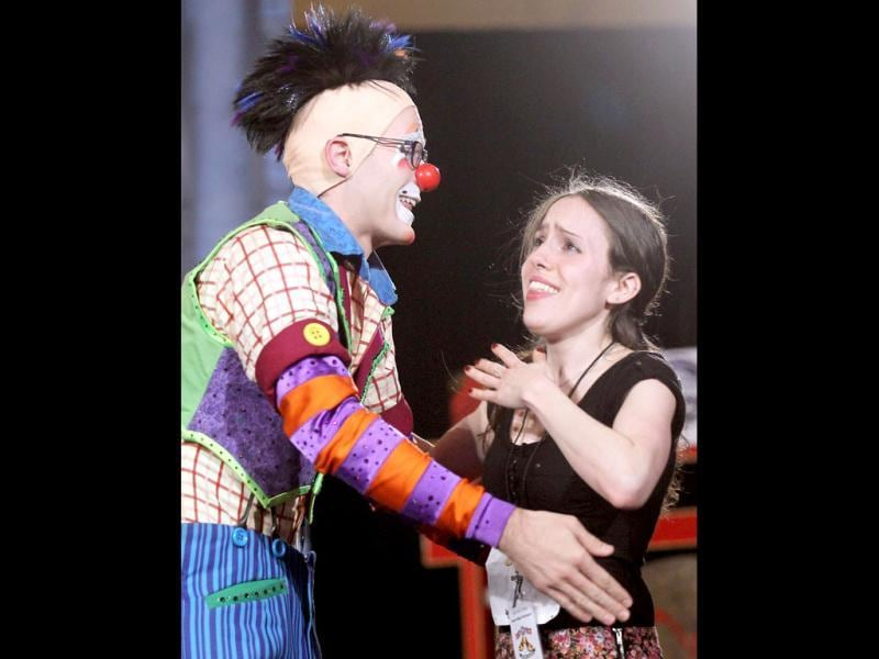 Auditioner Jordan Lewinter (R) is hugged by a Ringling Bros. and Barnum & Bailey circus clown after performing during