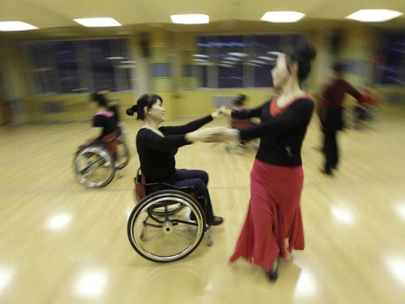 Physically disabled Liu Wei practises modern dance with her partner at a disabled persons activity center in Beijing. Two times a week, a group of 42 dancers including 24 women with physical disabilities, mostly between the ages of 21 and 62, from the commonwealth organization of the Beijing Disabled Dance Team practice modern dance using wheelchairs since 2009, according to the organizer. Reuters/Jason Lee.
