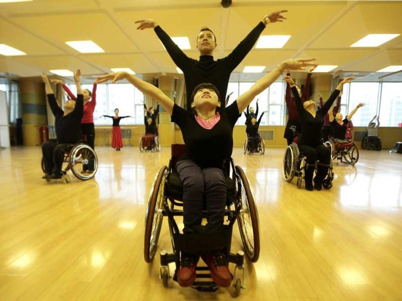 Physically disabled Chen Liting and an instructor practise modern dance at a disabled persons activity center in Beijing. Two times a week, a group of 42 dancers including 24 women with physical disabilities, mostly between the ages of 21 and 62, from the commonwealth organization of the Beijing Disabled Dance Team practice modern dance using wheelchairs since 2009, according to the organizer. Reuters/Jason Lee.