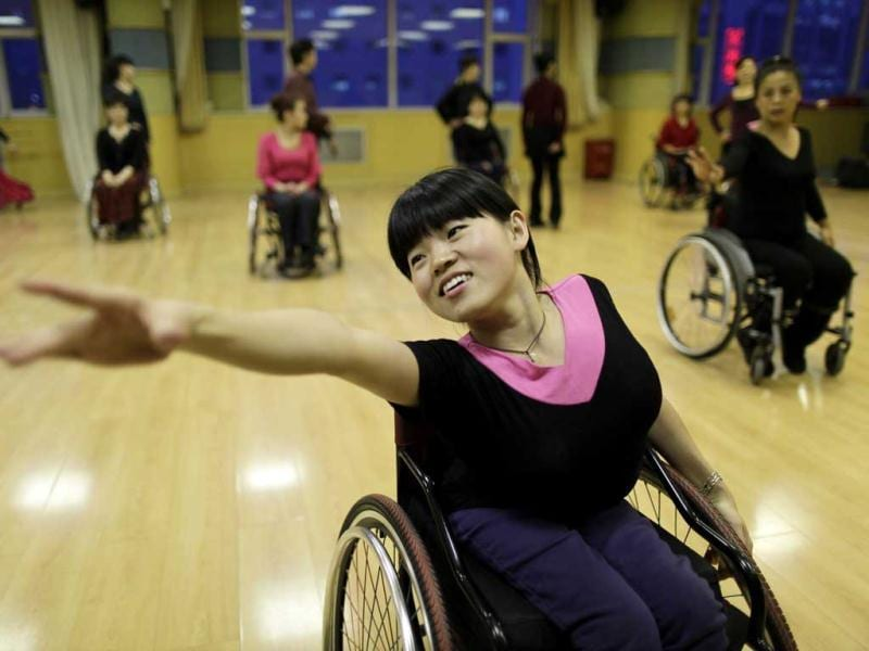 Physically disabled Chen Liting practises modern dance at a disabled persons activity center in Beijing. Two times a week, a group of 42 dancers including 24 women with physical disabilities, mostly between the ages of 21 and 62, from the commonwealth organization of the Beijing Disabled Dance Team practice modern dance using wheelchairs since 2009, according to the organizer. Reuters/Jason Lee.