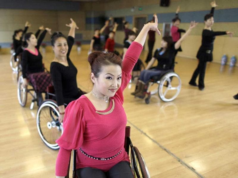 Physically disabled Dong Jingli and others practise modern dance at a disabled persons activity center in Beijing. Two times a week, a group of 42 dancers including 24 women with physical disabilities, mostly between the ages of 21 and 62, from the commonwealth organization of the Beijing Disabled Dance Team practice modern dance using wheelchairs since 2009, according to the organizer. Reuters/Jason Lee.