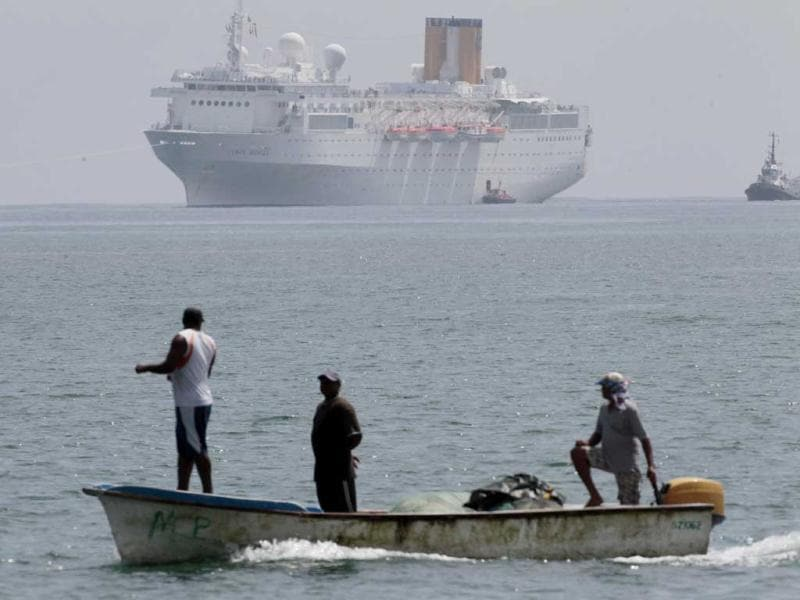 The Costa Allegra Cruise ship, is towed in the Victoria's harbor, Seychelles Island. The disabled cruise ship arrived in port in the island nation of the Seychelles after three days at sea without power.  AP Photo/Gregorio Borgia