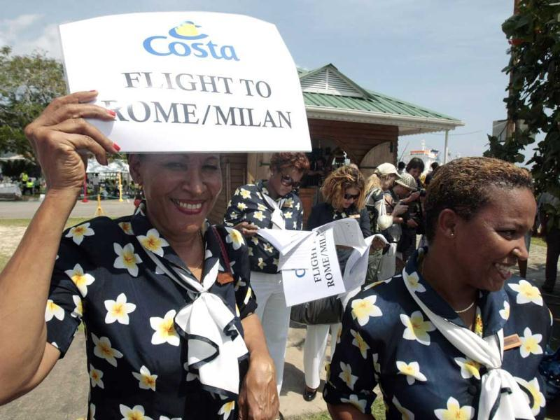 Hostesses wait for passengers of the Costa Allegra cruise ship to arrive in Victoria, Seychelles Island. The disabled cruise ship arrived in port in the island nation of the Seychelles on Thursday morning after three days at sea without power. AP Photo/Gregorio Borgia