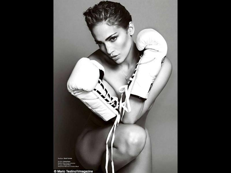 Jennifer Lopez posed completely nude with nothing but a pair of boxing gloves to cover her modesty for V magazine's new Sports Issue.