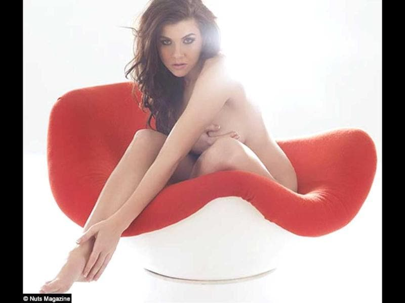 Imogen Thomas, who is better known for her affair with footballer Ryan Giggs, posed completely naked in her latest photoshoot for Nuts magazine. She is seen perching in a chair wearing nothing.