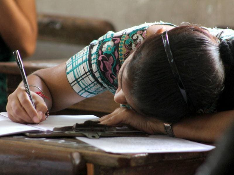 A student during her SSC examination in thane. HT Photo/Praful Gangurde
