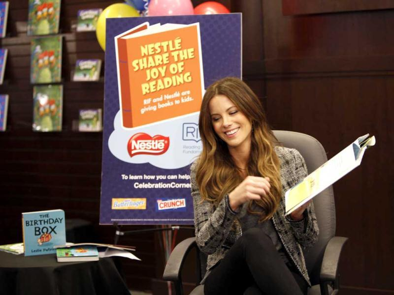 In this photo taken by AP Images for Nestlé, to help kick-off National Reading Month, Kate Beckinsale reads to young children and families during