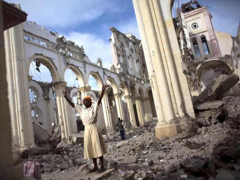 This photo won first place (international news) in the White House News Photographers Association (WHNPA) 2012 contest. A woman prays among the rubble of the damaged main cathedral in downtown Port-au-Prince, January 9, 2011. Reuters/Allison Shelley