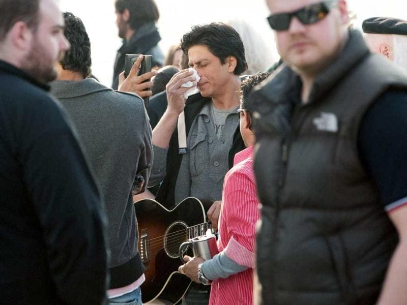Shah Rukh Khan has his make-up checked between takes while filming on the Southbank in central London.