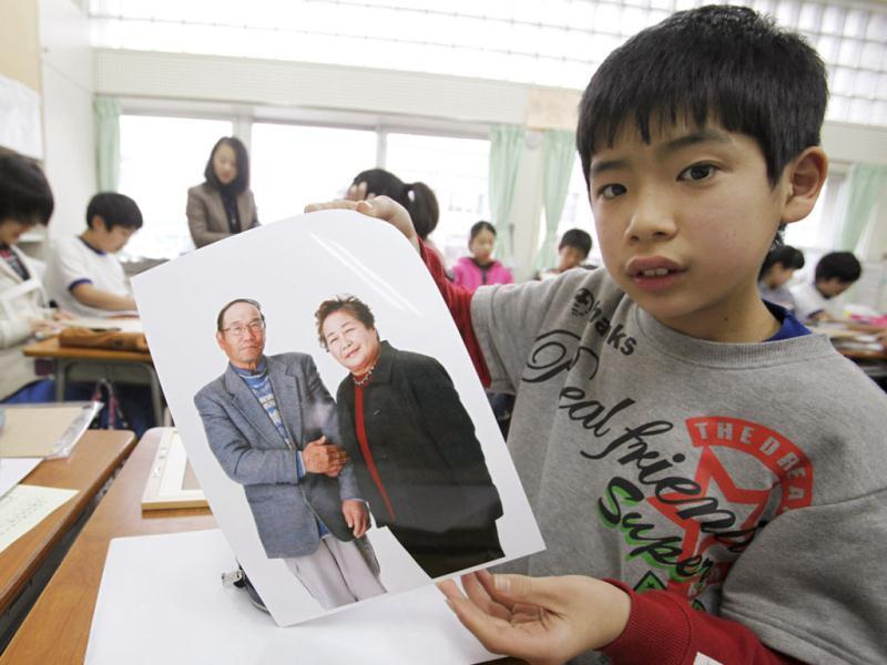 A sixth grade student from Keimei Gakuen elementary school in Akishima, on the outskirts of Tokyo, holds up a portrait of an earthquake survivor that he will frame as part of the 3.11 Portrait Project. The project was conceived by photographer Nobuyuki Kobayashi who, with the help of hair and makeup artists and other volunteers, takes portraits of earthquake survivors in Tohoku, many of whom lost all of their family pictures in the March 11, 2011 disaster. The portraits are then sent to schoolchildren from non-disaster areas, who frame the portraits and send them back to the survivors along with personal messages of support. Reuters/Yuriko Nakao