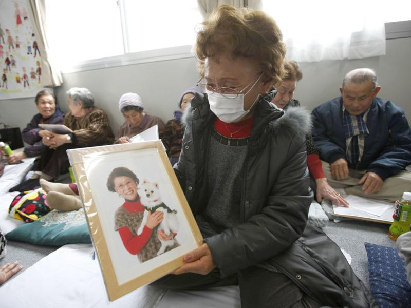 Katsuko Abe, 71, looks at her framed portrait after receiving it from 3.11 Portrait Project volunteers at the Midorigaoka temporary shelter in Koriyama, Fukushima prefecture in the Tohoku region. Reuters/Yuriko Nakao