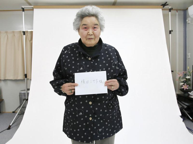 Misako Yokota poses for a portrait as part of the 3.11 Portrait Project at the Midorigaoka temporary shelter in Koriyama, Fukushima. Reuters/Yuriko Nakao