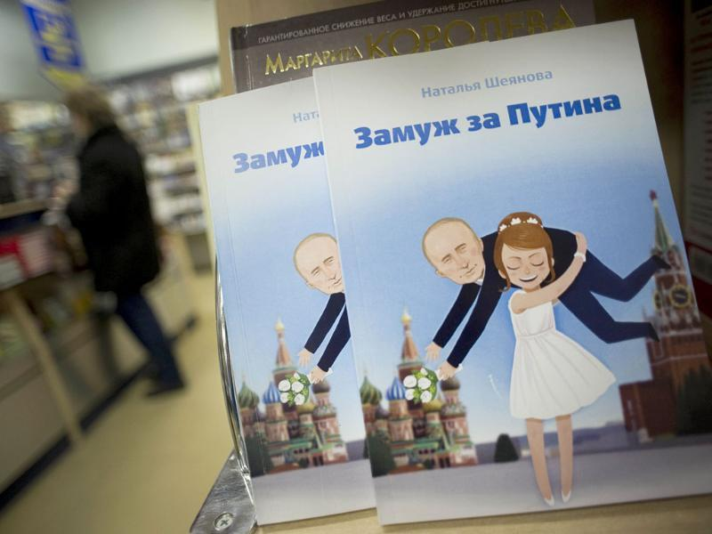 Copies of a book titled Marrying Putin, a woman's guide to attracting and marrying the right man, are displayed in a book store in Moscow. AFP Photo/Natalia Kolesnikova