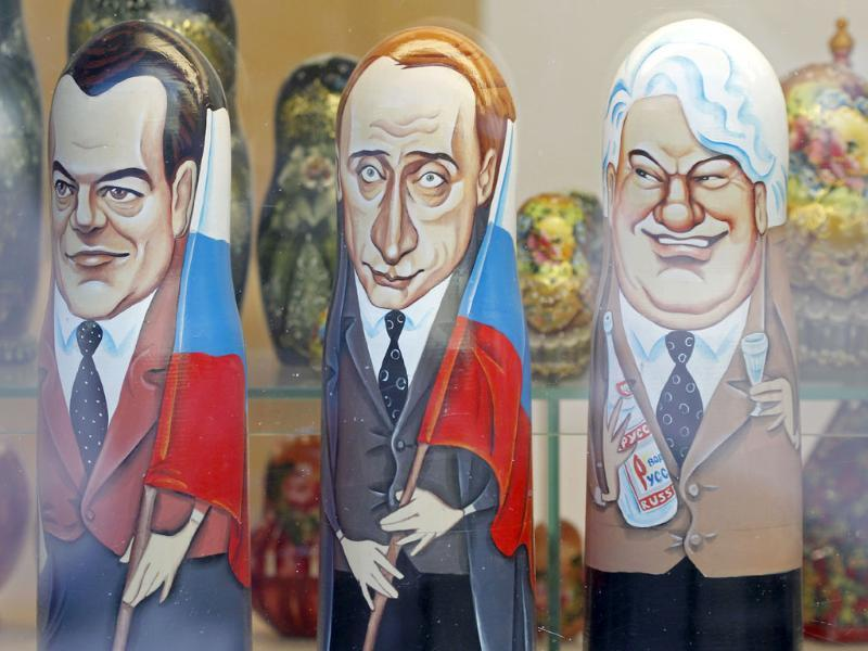Traditional Russian hand-painted wooden matryoshka dolls depicting Russian President Dmitry Medvedev (L) Russian Prime Minister and presidential candidate Vladimir Putin (C) and former Russian President Boris Yeltsin are displayed at a souvenir shop in Moscow. The presidential election will be held in Russia on March 4. AP Photo/Misha Japaridze