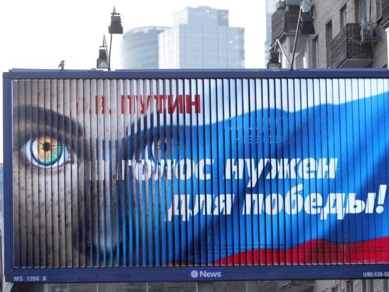 A pro-Putin election billboard reads 'V. Putin. Your vote is needed for victory' in downtown Moscow. AP Photo/Alexander Zemlianichenko