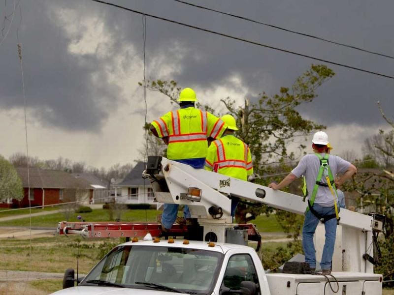 Charter cable workers keep a close eye on an approaching storm as sirens sound signaling a possible tornado in Athens, Alabama. (AP Photo/Butch Dill)