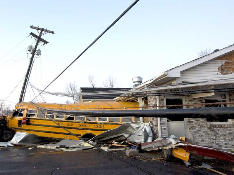 A school bus is pushed through the front of a building after a tornado swept through Henryville, Indiana. The storm was part of a system that brought high winds and heavy rain to parts of Indiana, Kentucky and Tennessee. (AP Photo/Philip Scott Andrews)