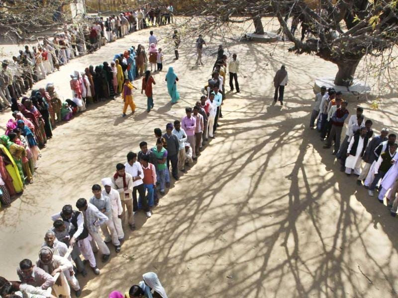 Voters stand in a queue to cast their votes at a polling station near Moradabad 158 kilometers (98.7 miles) from New Delhi. AP Photo/Manish Swarup.