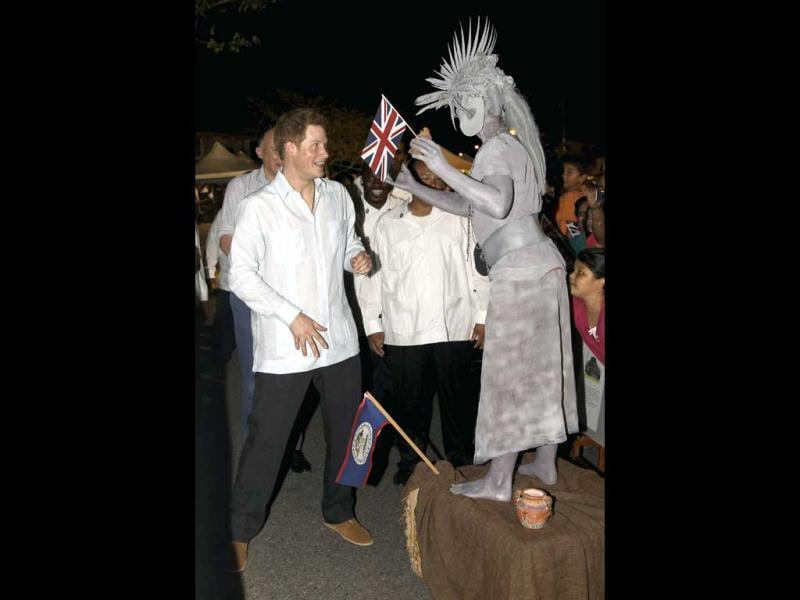 Britain's Prince Harry meets a human statue at a Jubilee Block Party in Belmopan, Belize. The Prince is on a week-long tour through Central America and the Caribbean acting as an ambassador for Britain's Queen Elizabeth as part of her Diamond Jubilee. Reuters/Chris Jackson/Pool