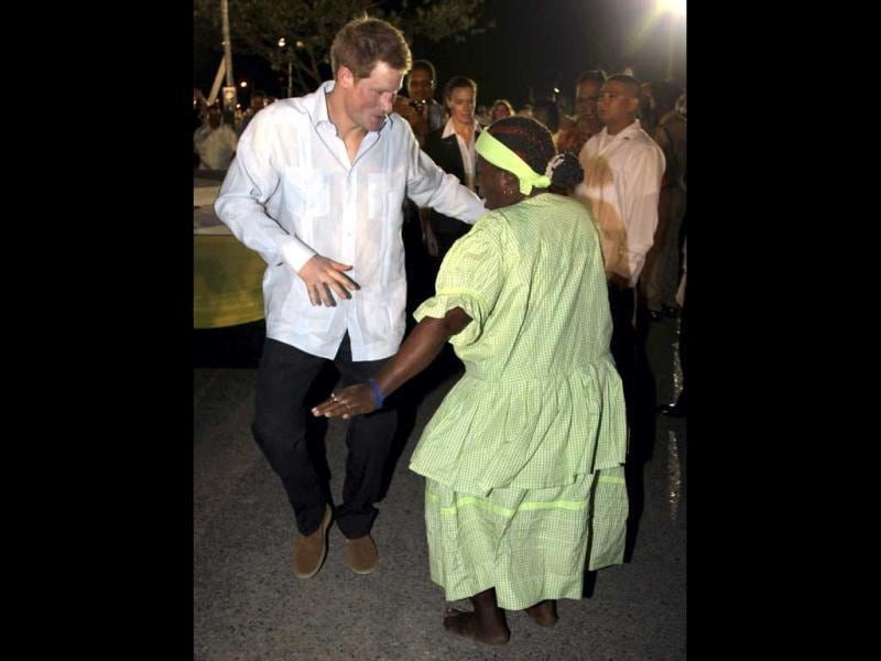 Britain's Prince Harry takes part in a dance at a Jubilee Block Party in Belmopan, Belize. The Prince is on a week-long tour through Central America and the Caribbean acting as an ambassador for Britain's Queen Elizabeth as part of her Diamond Jubilee. Reuters/Chris Jackson/Pool