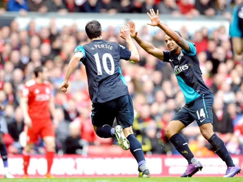 Arsenal's Dutch striker Robin van Persie (2nd R) celebrates scoring his first goal with English striker Theo Walcott (R) during the English Premier League football match between Liverpool and Arsenal at Anfield in Liverpool, north-west England. (AFP Photo/Paul Ellis)