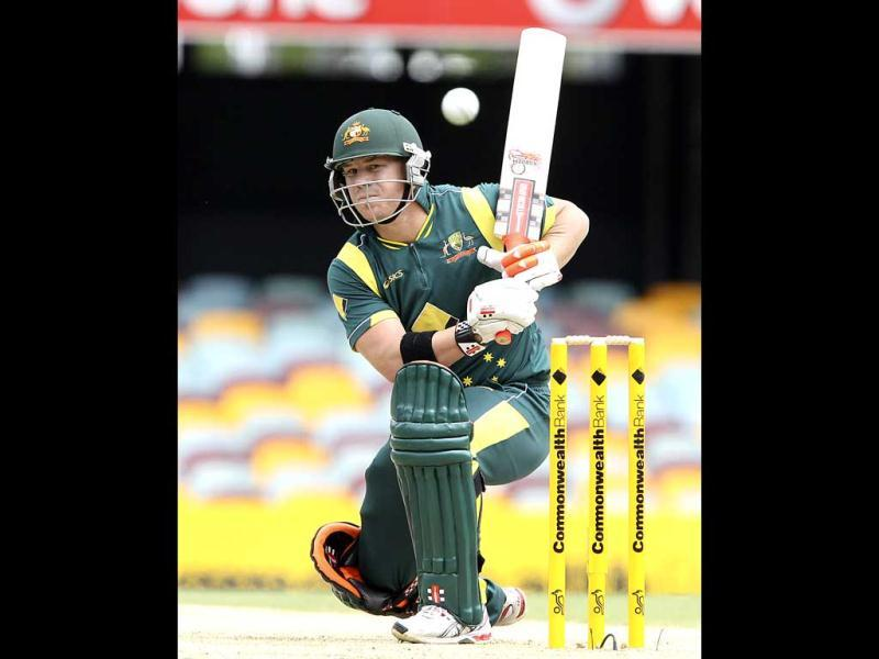 Australia's David Warner plays a shot during the first final match in the One Day International cricket series between Sri Lanka and Australia in Brisbane. AP Photo/Tertius Pickard