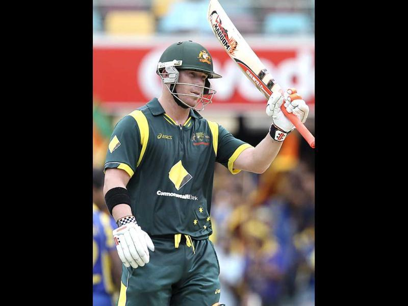 Australia's David Warner reaches 50 runs during the first final match in the one-day international cricket series against Sri Lanka in Brisbane. AP Photo/Tertius Pickard