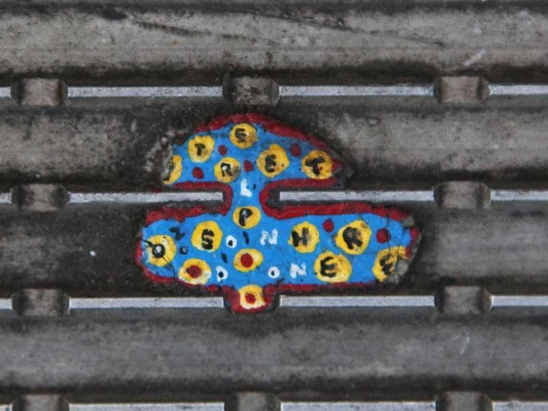 An old miniature painting made on discarded chewing gum by artist Ben Wilson is seen on the Millennium Bridge in London. Reuters/Finbarr O'Reilly