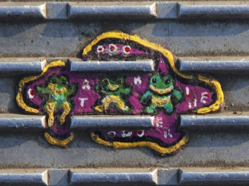 An old miniature painting made on discarded chewing gum is seen on the Millennium Bridge in London. Reuters/Finbarr O'Reilly