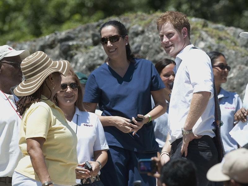 Britain's Prince Harry, center right, visits the Mayan temple at Xunantunich , Belize, on the second day of his ten-day tour to Belize, Bahamas, Jamaica, and Brazil. (AP Photo/Mark Large/Daily Mail /PA Wire)