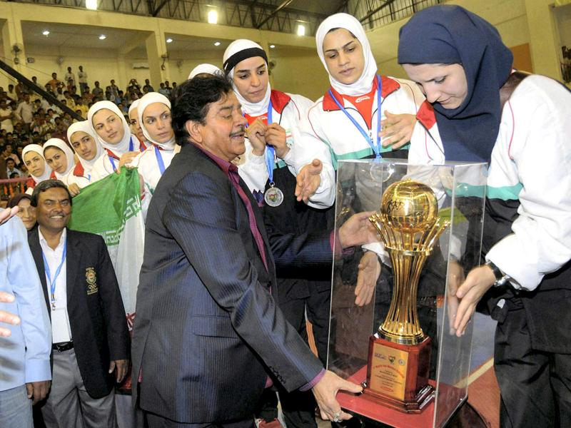 BJP MP Shatrughan Sinha presents the runners-up trophy to the Iranian team after they lost in the final against India at the first women's World Cup Kabaddi Championship in Patna. PTI Photo
