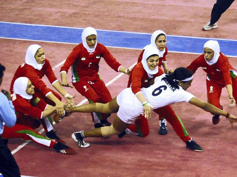 Indian and Irani players during the first women's World Cup Kabaddi Championship final match in Patna. PTI Photo