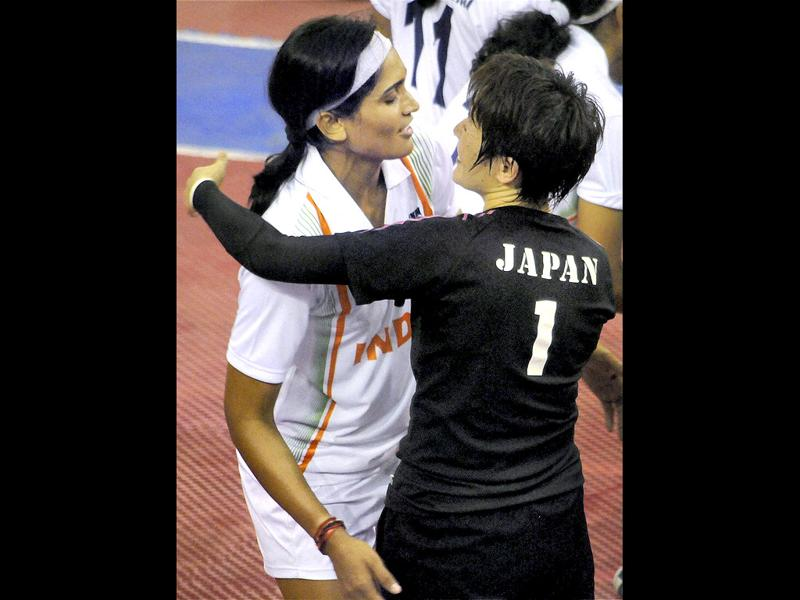 India's women's Kabaddi team captain hugs Japanese captain after their win in the semifinal match against Japan. PTI Photo