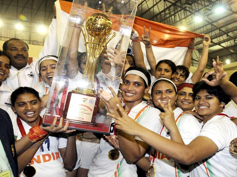 Indian players celebrate with the winners trophy of the first women World Cup Kabaddi Championship after beating Iran, in Patna. PTI Photo