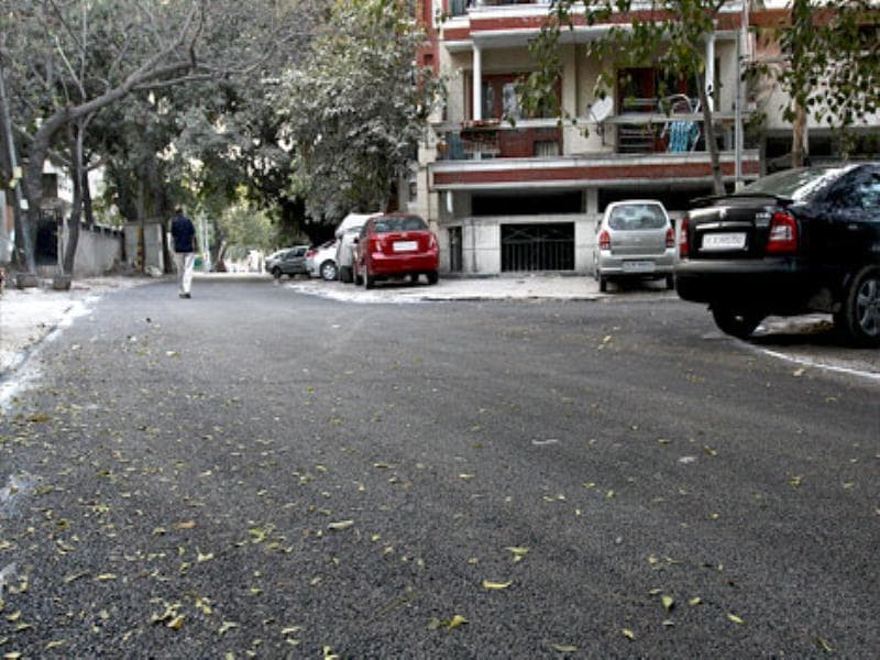 Bad road relaid almost overnight in Kailash Colony