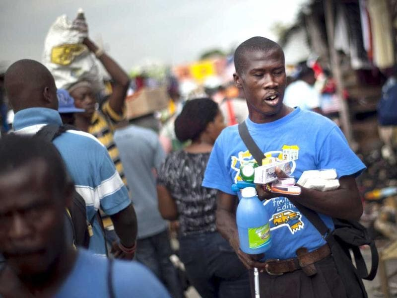 Victor Osner 34, a blind vendor, hawks hygienic products at a local market in Port-au-Prince, Haiti. AP Photo/Ramon Espinosa